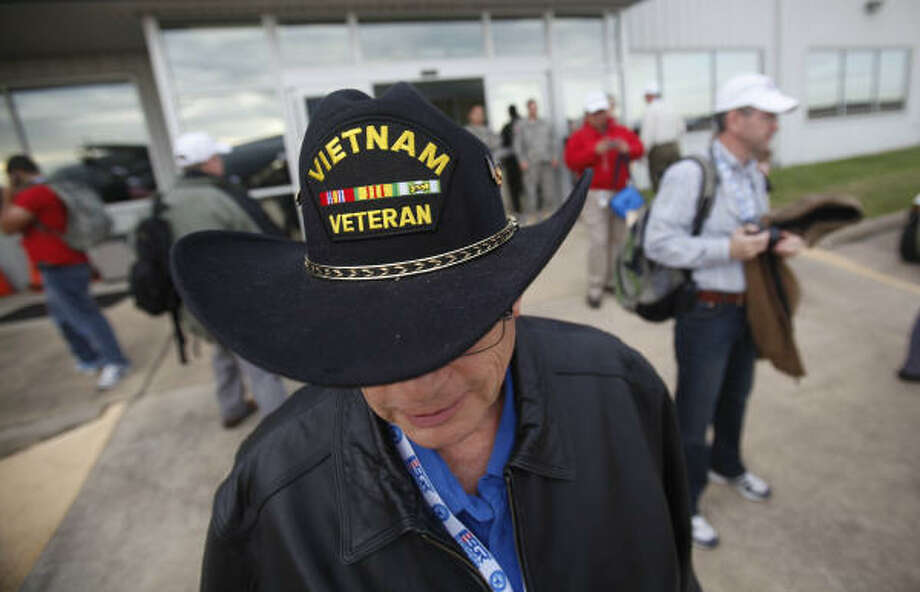 Mike Pyykola, representative of the Veteran of Foreign War Post 8790, waits to board a Hercules C-130 at Ellington Field. Photo: Mayra Beltran, Chronicle