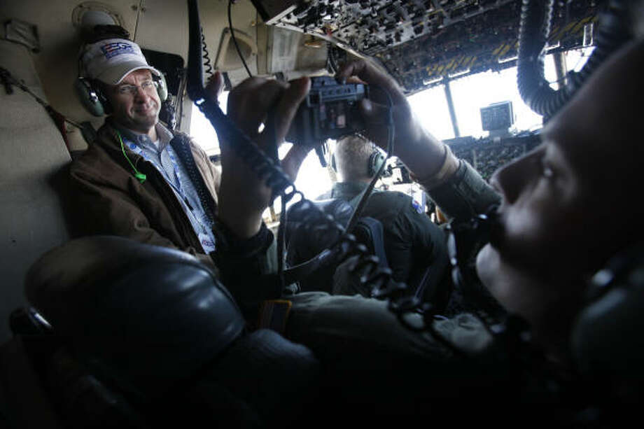 Rob Jamieson, Director of Field Engineering with EPCO, Inc., is photographed in the cockpit of the Hercules C-130. Photo: Mayra Beltran, Chronicle