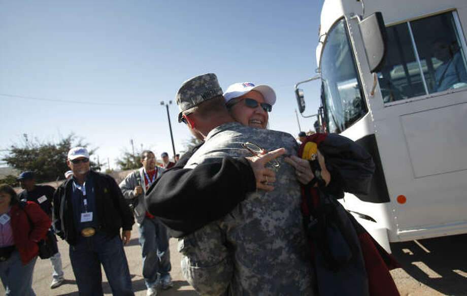 Melinda Grant, Associate Chair of Health & Kinesiology at Texas A&M College Station, embraces Cpt. Mark White as she greets him at Camp McGregor where employers are teamed with soldiers to give a better understanding about training and their jobs. Photo: Mayra Beltran, Chronicle