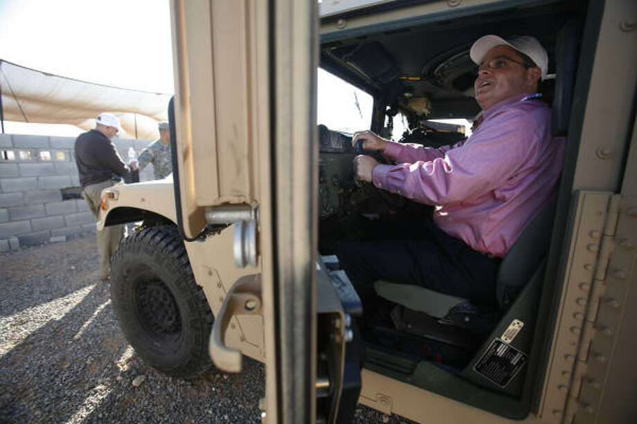 Ronnie Warner, of the Hunstville Wal-Mart, sits inside a humvee at Camp McGregor. Photo: Mayra Beltran, Chronicle