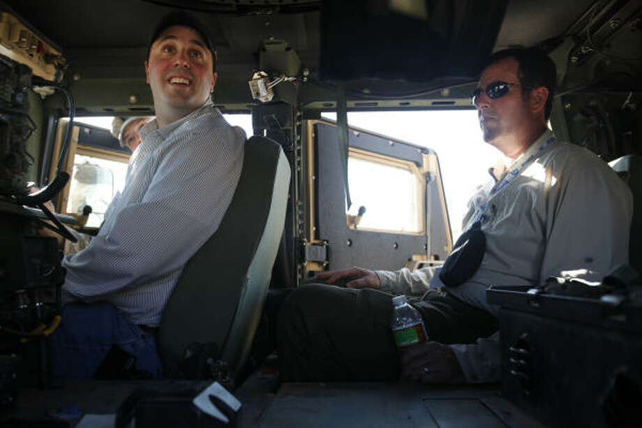 Dustin Dickschat, of Irving, and Craig Hardee, of Houston, sit inside a humvee at Camp McGregor. Photo: Mayra Beltran, Chronicle