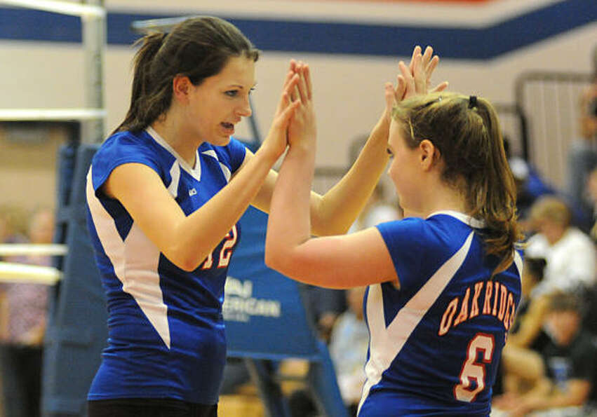 Oak Ridge's Alyssa Short and Brianna Riggs celebrate a point.