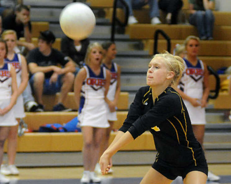 Conroe's Ashley Wilson bumps the ball.