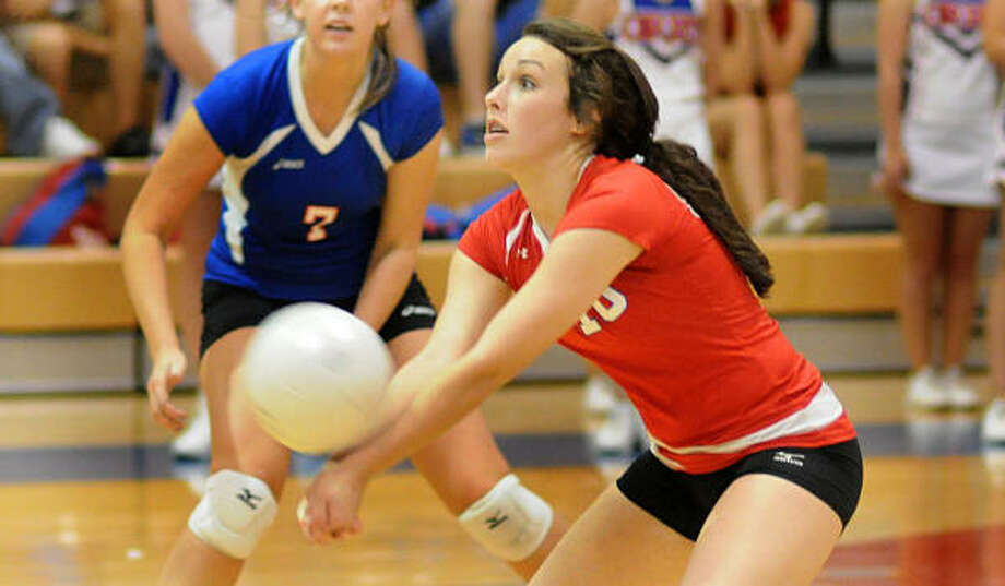Oak Ridge's Hannah Bullock bump sets a serve. Photo: David Hopper, For The Chronicle