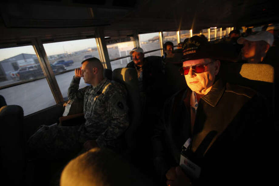 Mike Pyykola, representative of the Veteran of Foreign War Post 8790, takes a bus ride to Camp McGregor where employers and community representatives are teamed with soldiers to give a better understanding about training and their jobs.