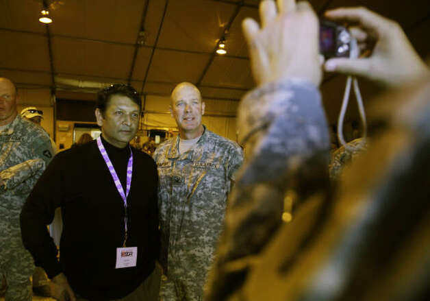 Jeet Kar, Houstonian of Aker Solutions, is photographed with Col. Mark Campsey after lunch at Camp McGregor.