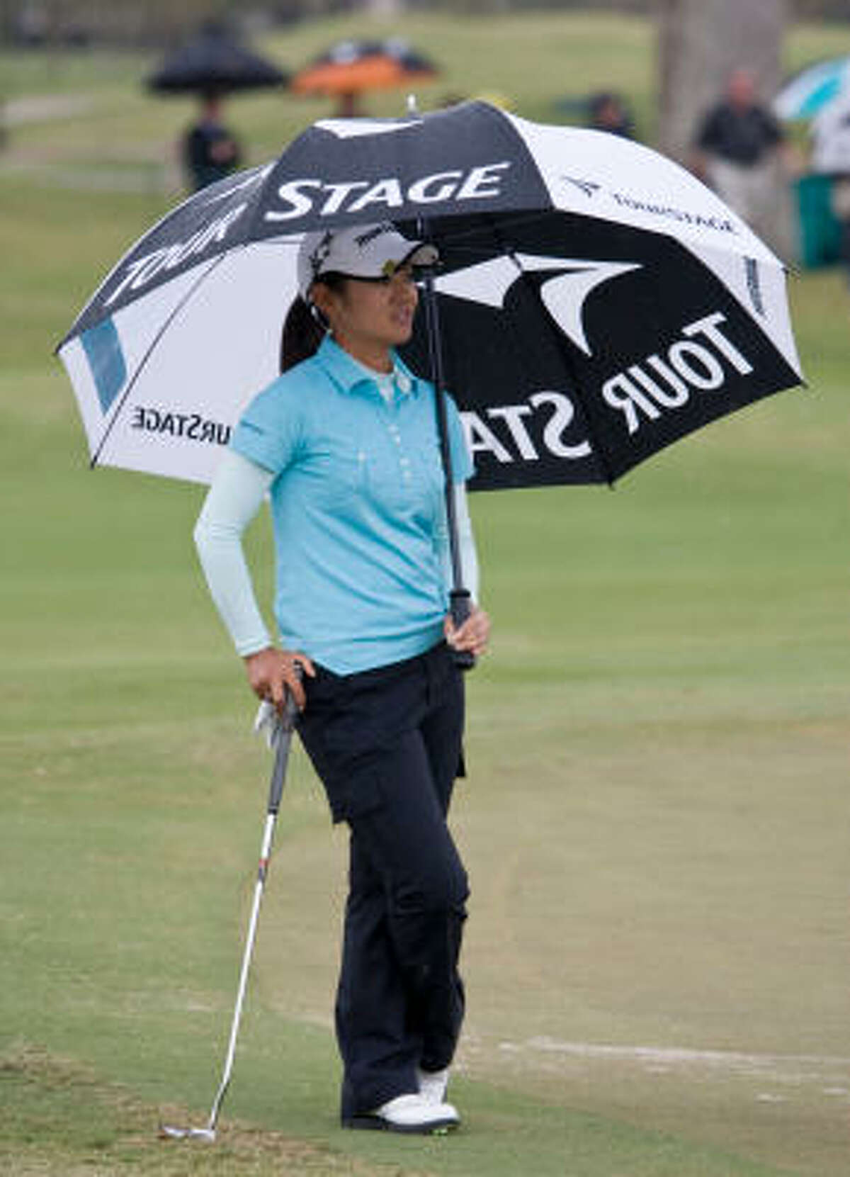 Ai Miyazato tries to stay dry during Friday's second round.