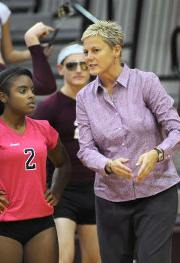 Magnolia head volleyball coach Terri Johnson, right, talks to LaTasha Jones. Photo: Jerry Baker, For The Chronicle