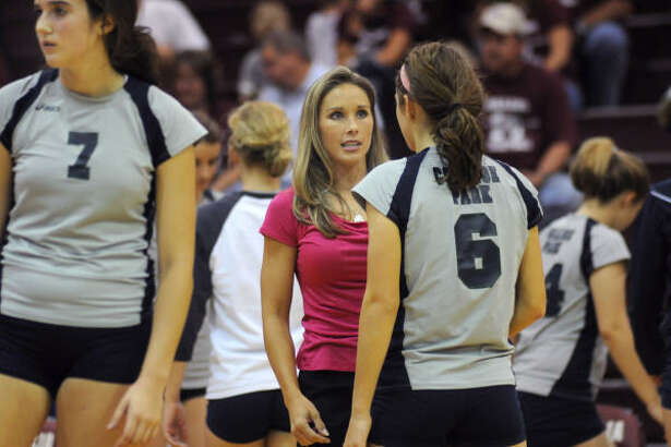 College Park head volleyball coach Candice Collins, center, pumps up her sophomore setter, Michelle Griffith.