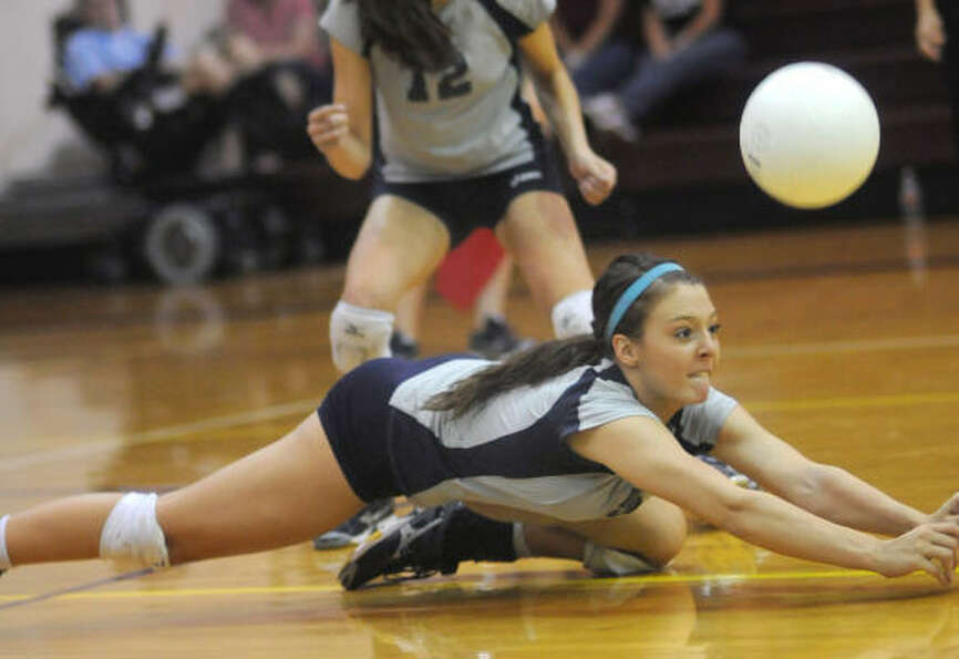 College Park senior middle blocker and outside hitter Lauren Chapman hits the ground to get a dig.