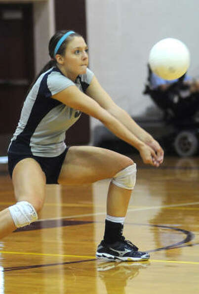 College Park senior middle blocker and outside hitter Lauren Chapman bumps the ball.