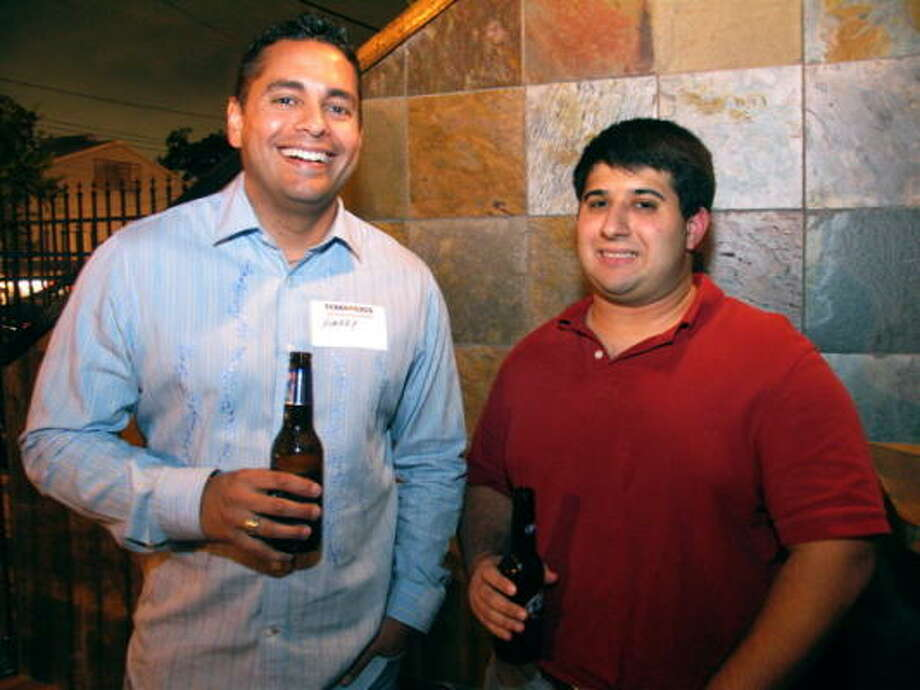 Longhorn and Aggie alum groups joined together at Ei8ht on Washington Ave. for drinks and a good time Thursday night. Pictured: Harry Torres, left, and Jason Robbins Photo: Jordan Graber, For The Chronicle