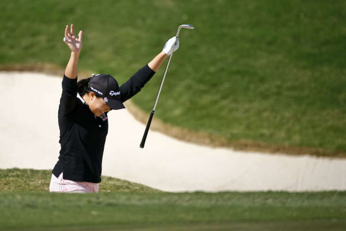 Irene Cho celebrates after hitting her ball out of the sand trap on the 18th hole and into the cup during the first round of the LPGA Tour Championship on Thursday at the Houstonian Golf & Country Club in Richmond.