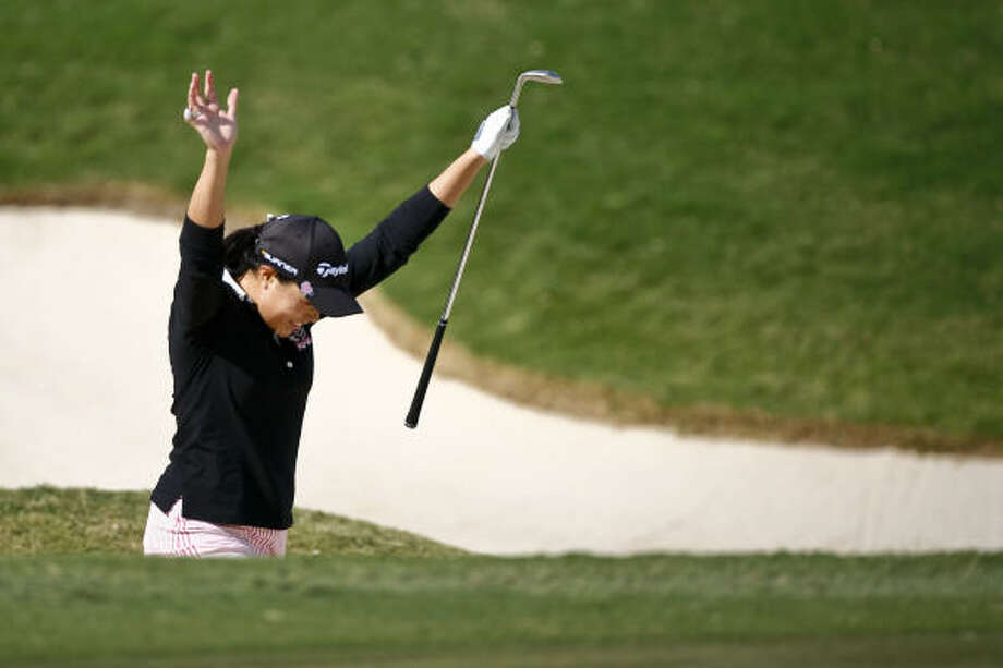 Irene Cho celebrates after hitting her ball out of the sand trap on the 18th hole and into the cup during the first round of the LPGA Tour Championship on Thursday at the Houstonian Golf & Country Club in Richmond. Photo: Michael Paulsen, Chronicle