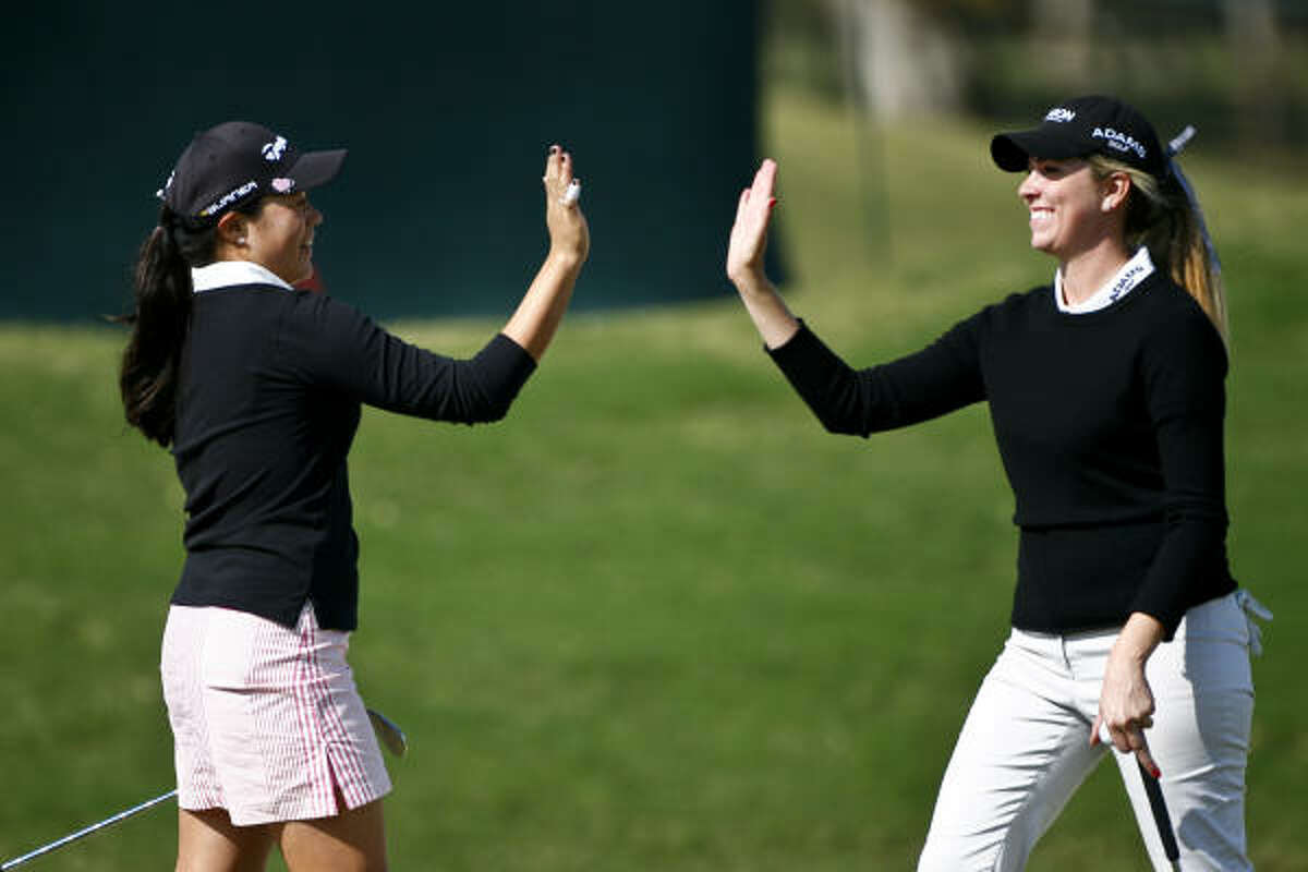 Irene Cho celebrates with Taylor Leon after Cho holed her sand shot.