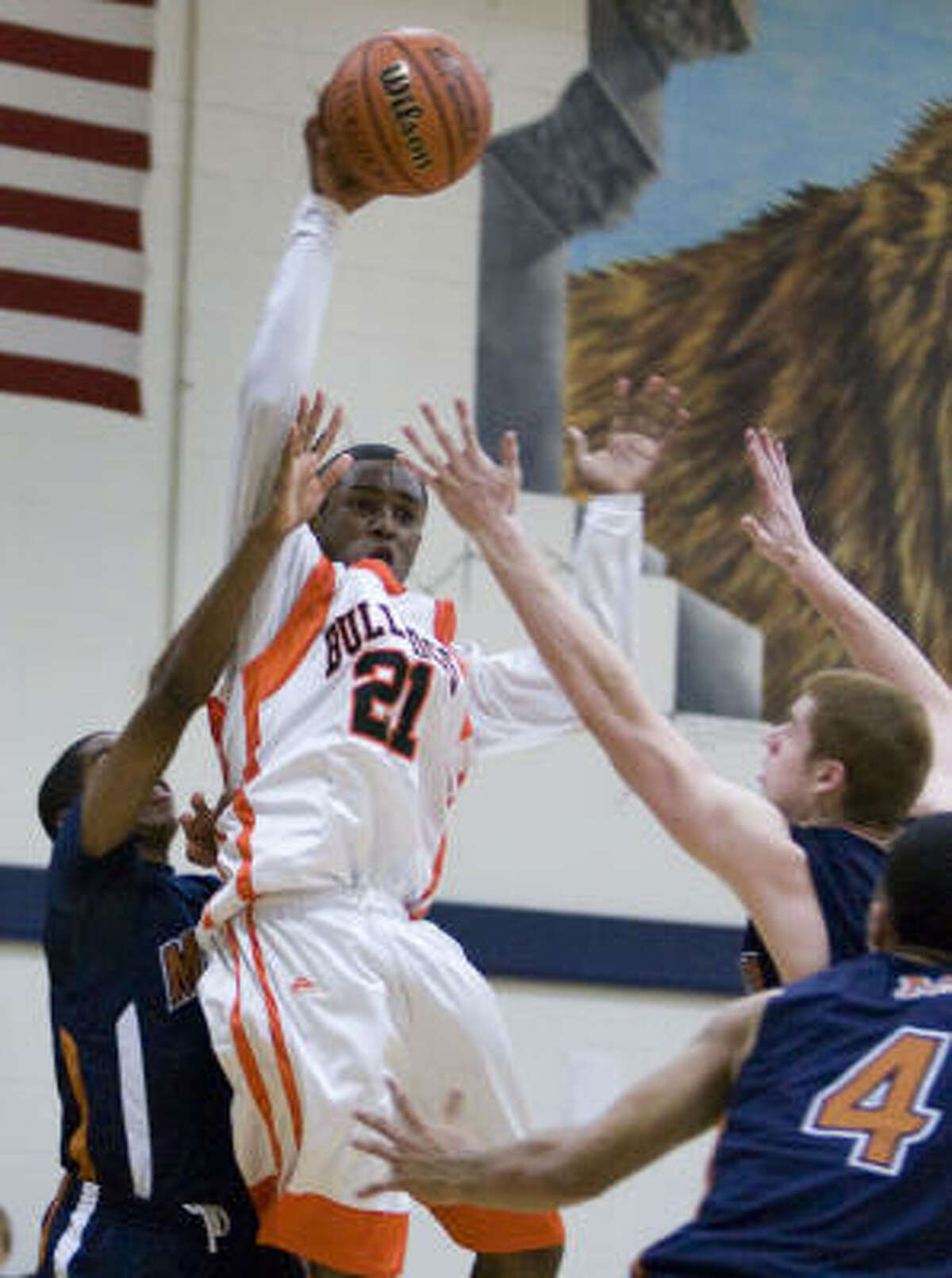 LaPorte guard Drew Parker (21) leaps to make a pass over a group of San Antonio Madison defenders.