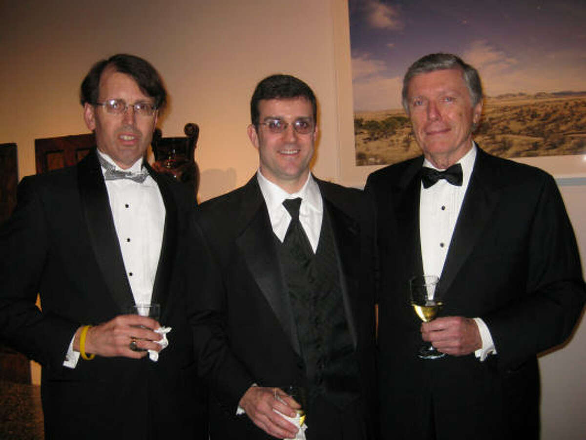Evans Attwell, Bill Merrill and H. Lee Godfrey. Godfrey chaired the event and purchased two Peruvian ceramic vessels for the MFAH in honor of his grandchildren.
