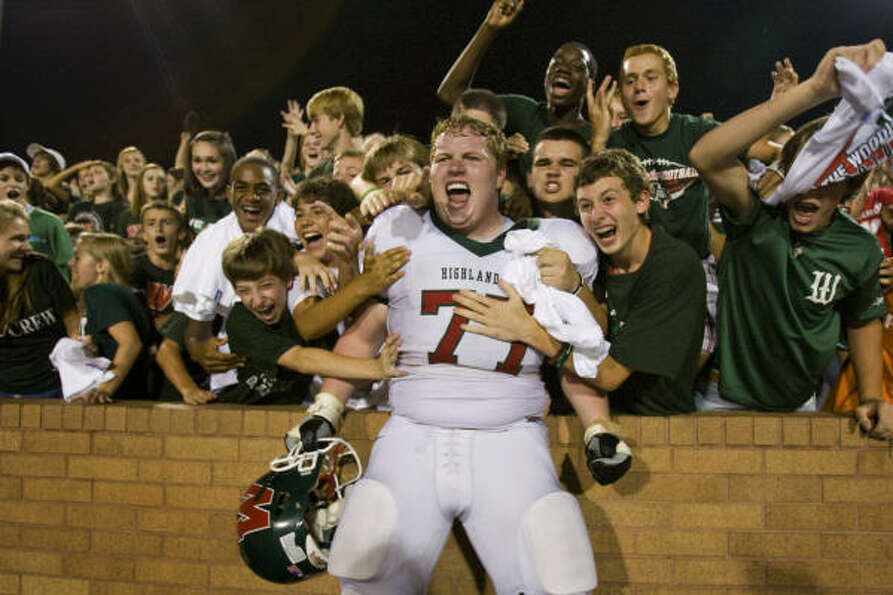 The Woodlands lineman Chad Lindsay celebrates with fans following the Highlanders 31-27 victory over