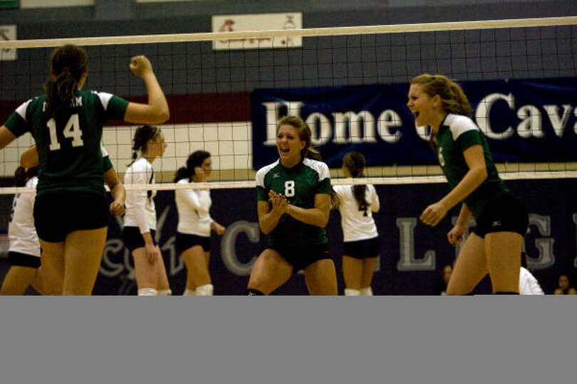 Brenham players Emily Albus (#14), Caroline Young (#8) and Molly Duge (#6) celebrate a point in the