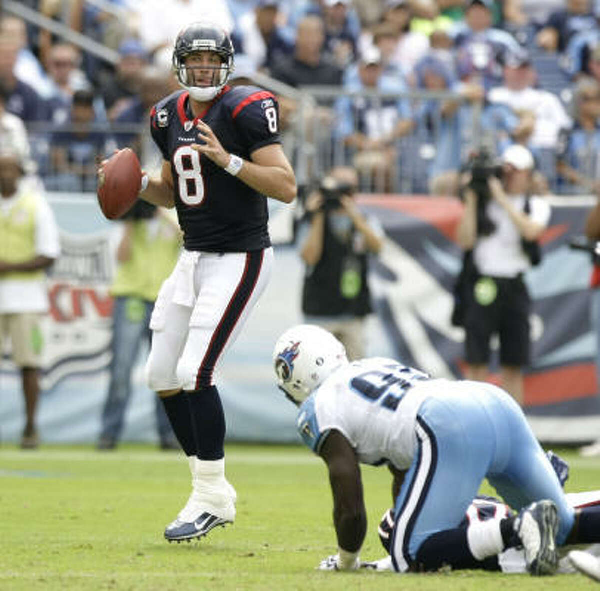 Houston Texans quarterback Matt Schaub (8) looks over an open receiver during the second quarter of an NFL football game against the Tennessee Titans at LP Field Sunday, Sept. 20, 2009, in Nashville. Schaub found Andre Johnson for a 72-yard touchdown reception on the play. The Texans beat the Titans 34-31. ( Brett Coomer / Chronicle )