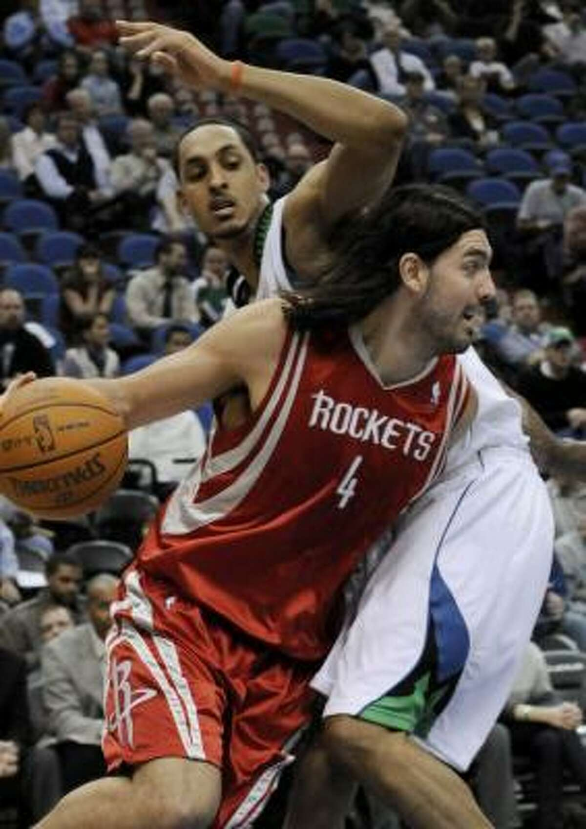 Rockets 97, Timberwolves 84 Rockets forward Luis Scola drives around the Timberwolves' Ryan Hollins during the first quarter.
