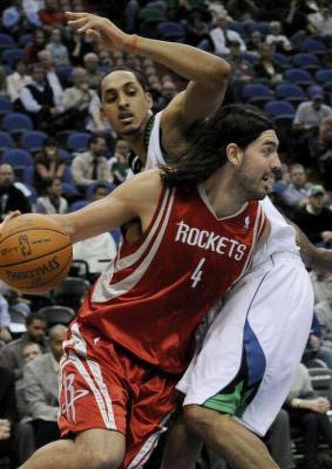 Rockets 97, Timberwolves 84Rockets forward Luis Scola drives around the Timberwolves' Ryan Hollins during the first quarter. Photo: Jim Mone, AP
