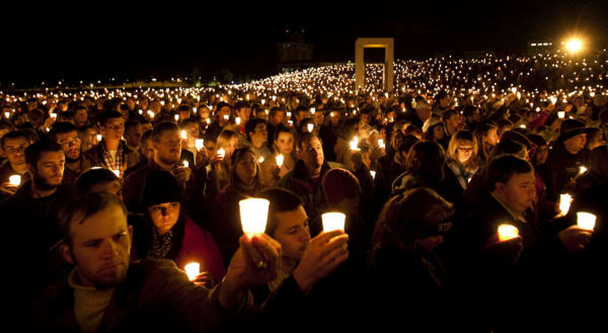 Hundreds attend a candlelight vigil at 2:42 a.m. on the exact time of the 10th anniversary of the 1999 Bonfire collapse. The Bonfire began in 1909 as a tradition before the Texas A&M-Texas football game.