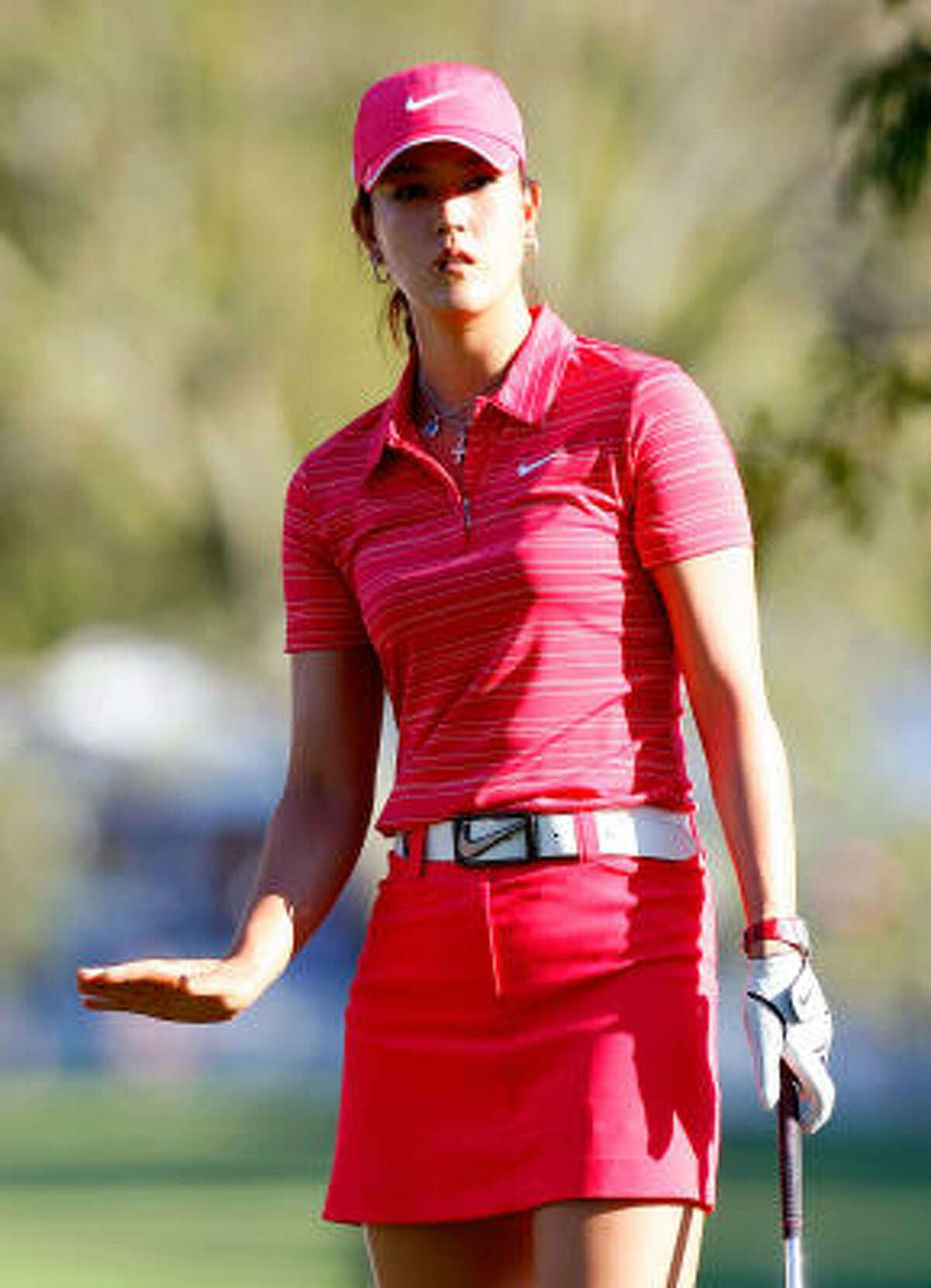 If you watched Michelle Wie win her first major at the Lorena Ochoa Invitational in Mexico on Sunday, you saw her in head-to-toe Nike pink. Sure, her wardrobe is fairly scripted by her sponsor, but the 20-year-old Wie does have some say in what she wears when she works.