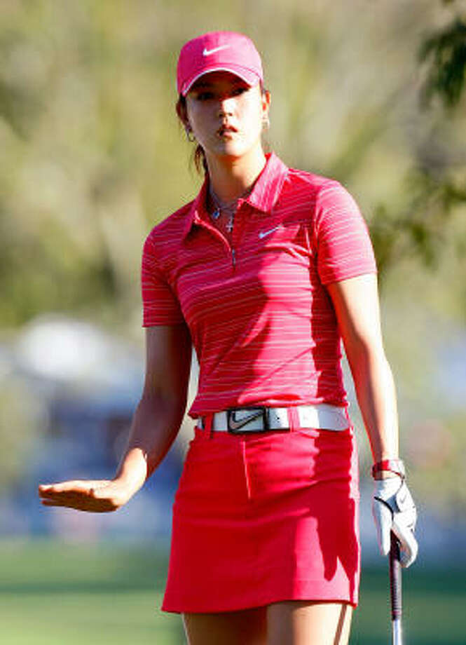 If you watched Michelle Wie win her first major at the Lorena Ochoa Invitational in Mexico on Sunday, you saw her in head-to-toe Nike pink. Sure, her wardrobe is fairly scripted by her sponsor, but the 20-year-old Wie does have some say in what she wears when she works. Photo: Kevin C. Cox, Getty Images