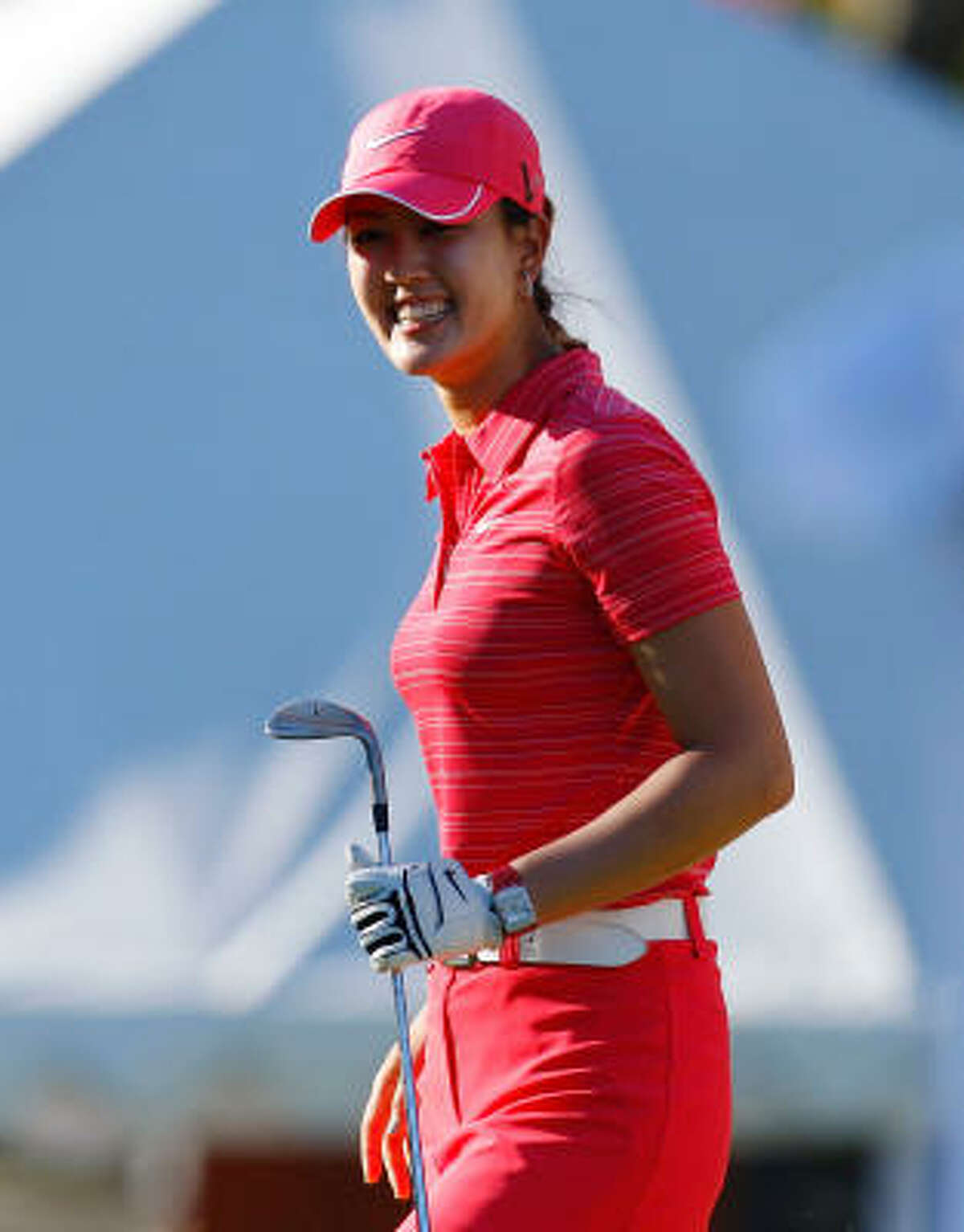 Michelle Wie, sponsored by Nike, is a contemporary dresser, but still wears matched styles such as this Nike Tech skort and Nike mesh striped polo. She often accessorizes with large earrings and necklaces.