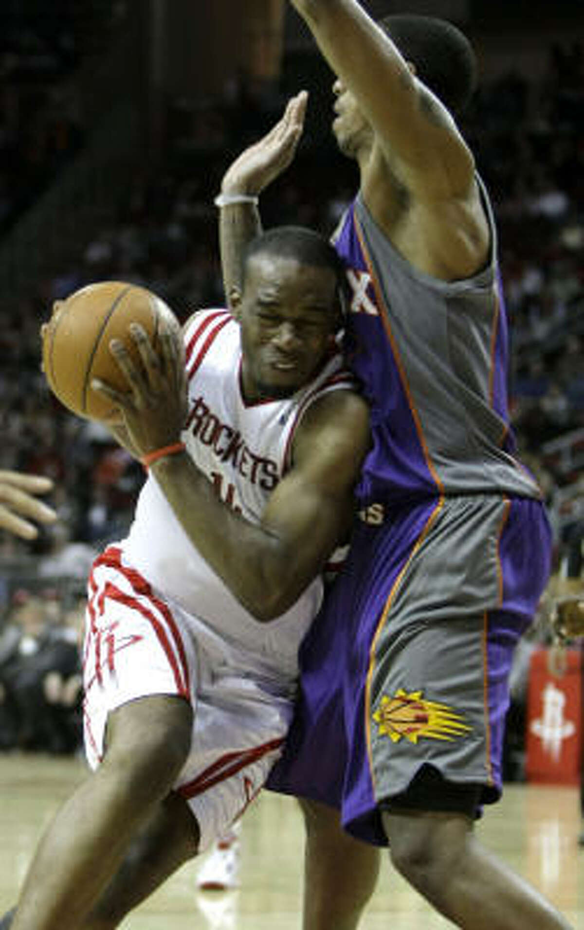 Rockets forward Carl Landry, left, scored a game-high 27 points off the bench in Tuesday's game against the Phoenix Suns, but Houston came up short in an 111-105 loss at Toyota Center.
