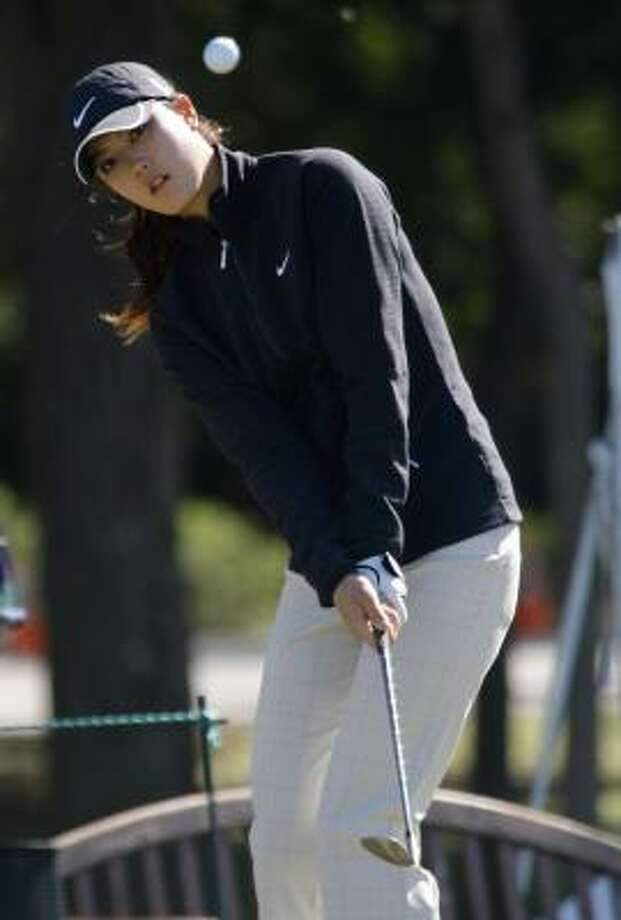 Michelle Wie chips at the practice green during Tuesday's practice round at The Houstonian Golf and Country Club in Richmond. Photo: Melissa Phillip, Chronicle
