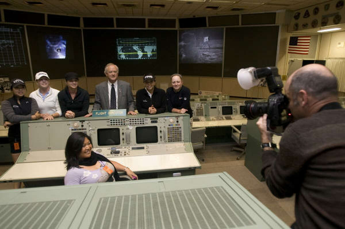 LPGA golfers including The Woodlands' own, Stacy Lewis, right, get their photo taken with Milt Heflin, center, associate director with NASA in the historical Apollo Missions Operation Control Room.