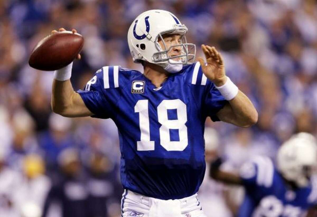 Nov. 15: Colts 35, Patriots 34 Colts quarterback Peyton Manning threw four touchdown passes in Sunday's win over the Patriots, including the go-ahead 1-yard touchdown pass to Reggie Wayne with 13 seconds remaining.
