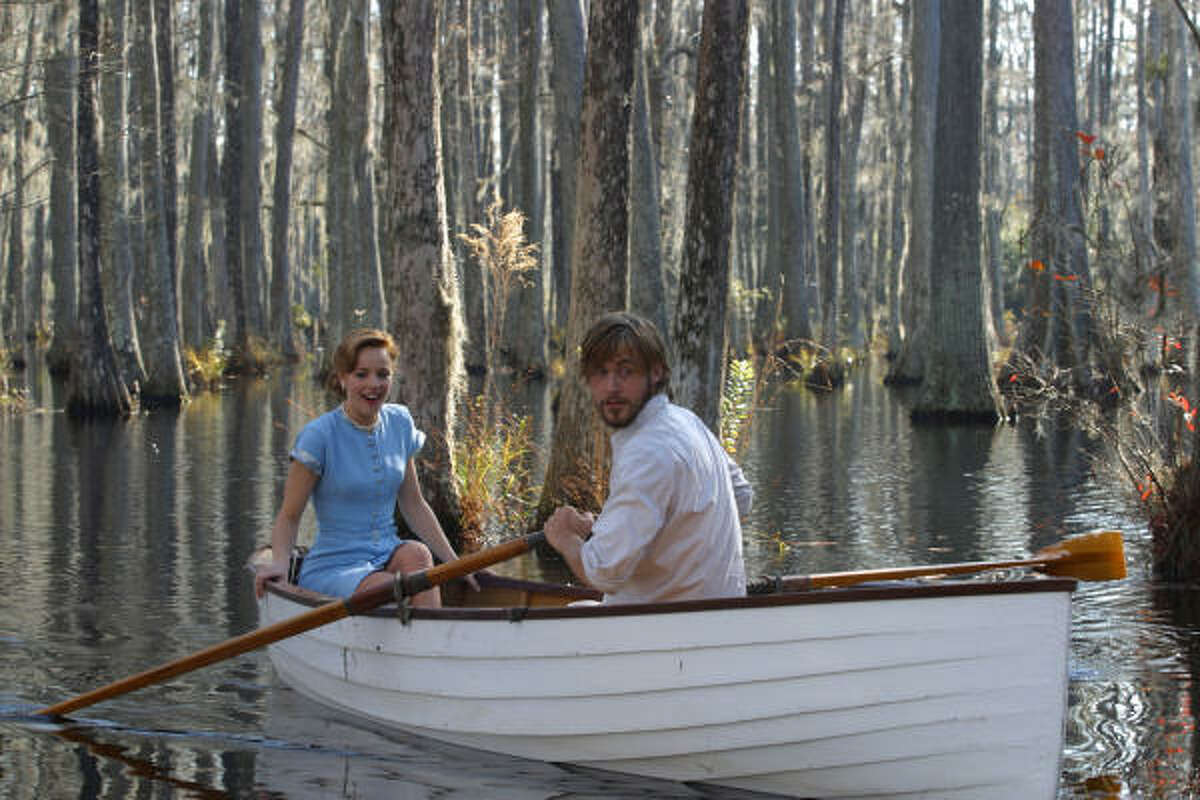 059_DF_004917 (left to right) Rachel McAdams as Allie and Ryan Gosling as Noah in New Line Cinema's romantic drama, ``The Notebook.'' Photo: © 2004 Melissa Moseley, SMPSP/New Line Productions. HOUCHRON CAPTION (06/25/2004): Love blossoms as Noah (Ryan Gosling) and Allie (Rachel McAdams) take a romantic boat ride in ``The Notebook.''