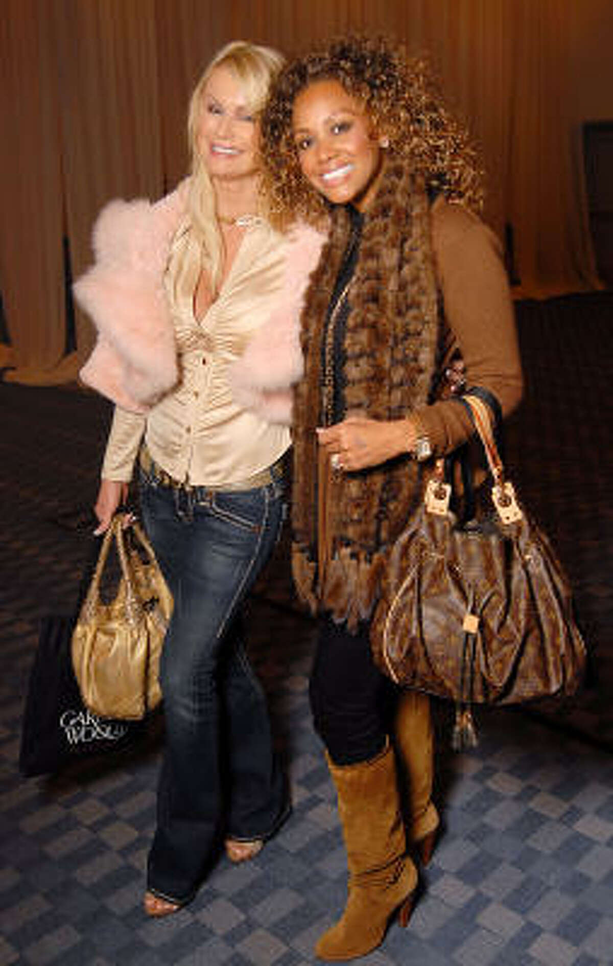 Hege Jessen and Kym Jackson at the Saks Fifth Avenue Fashion Show and Luncheon at the Nutcracker Market.