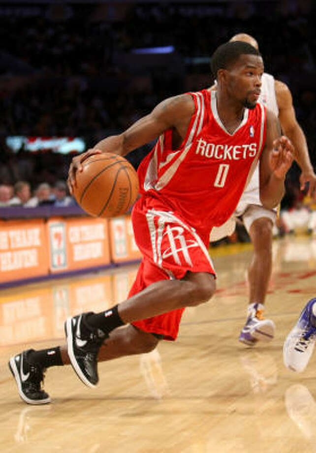 Rockets guard Aaron Brooks scored a career-high 33 points to lead the Rockets to a 101-91 win over the Los Angeles Lakers on Sunday night in Los Angeles. Photo: Stephen Dunn, Getty Images