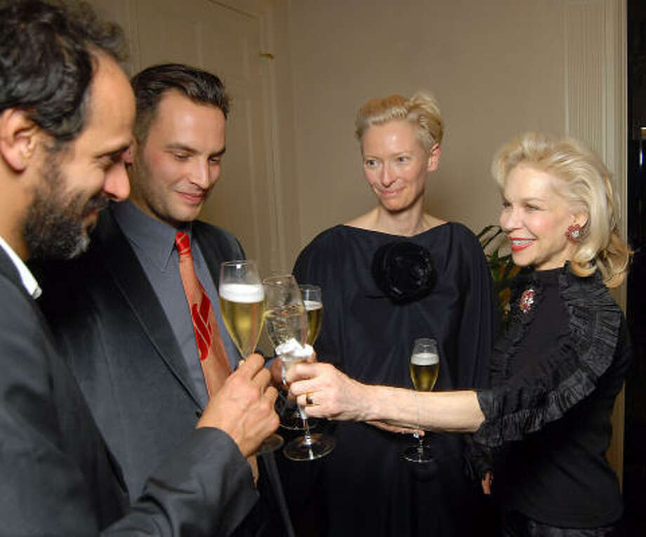 From left: Luca Guadagnino, Sandro Kopp, Tilda Swinton and Lynn Wyatt toast at a champagne reception honoring  Swinton at Wyatt's home. Photo: Dave Rossman, For The Chronicle