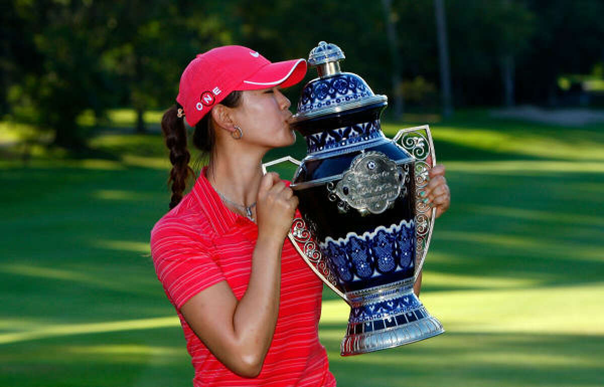 Michelle Wie won her first LPGA Tour title, fulfilling the promise of a decade with a 3-under 69 Sunday for a two-stroke victory over Paula Creamer in the Lorena Ochoa Invitational.