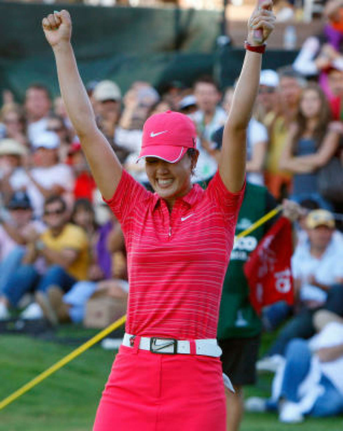 Michelle Wie reacts after winning the Lorena Ochoa Invitational at Guadalajara Country Club.