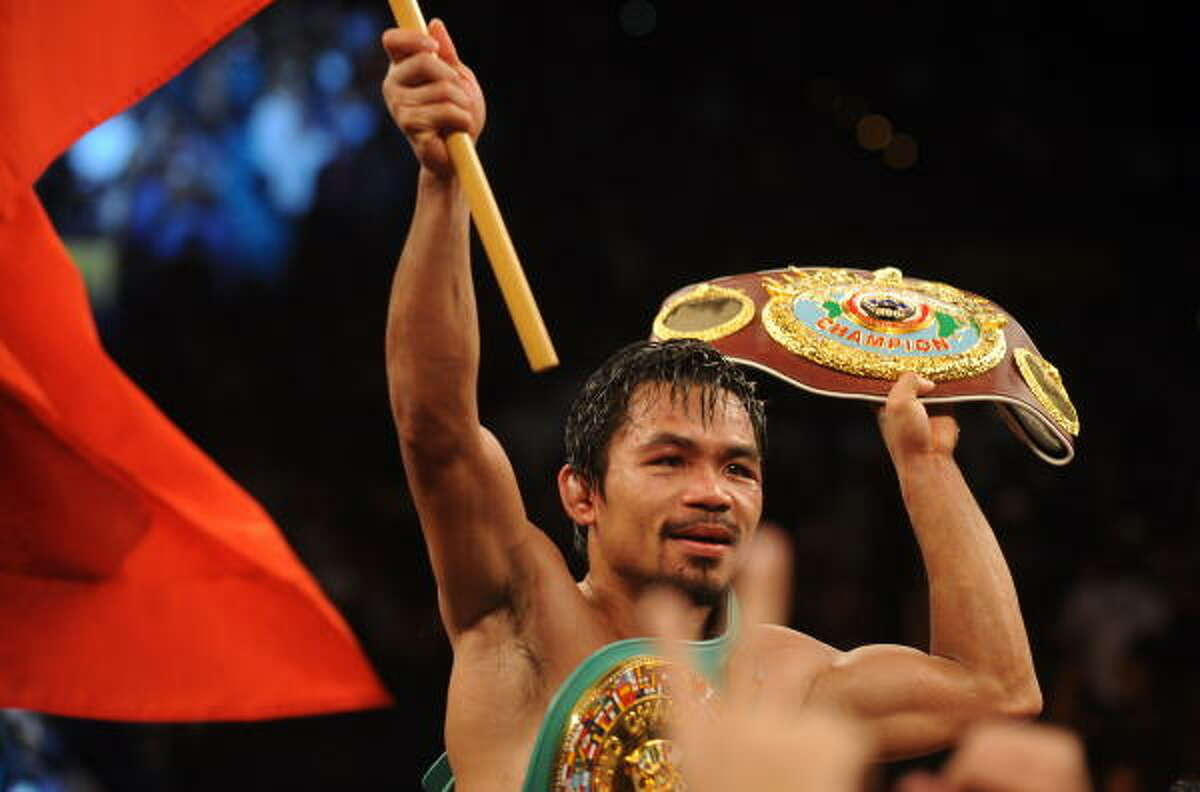 Manny Pacquiao celebrates after defeating Miguel Cotto.