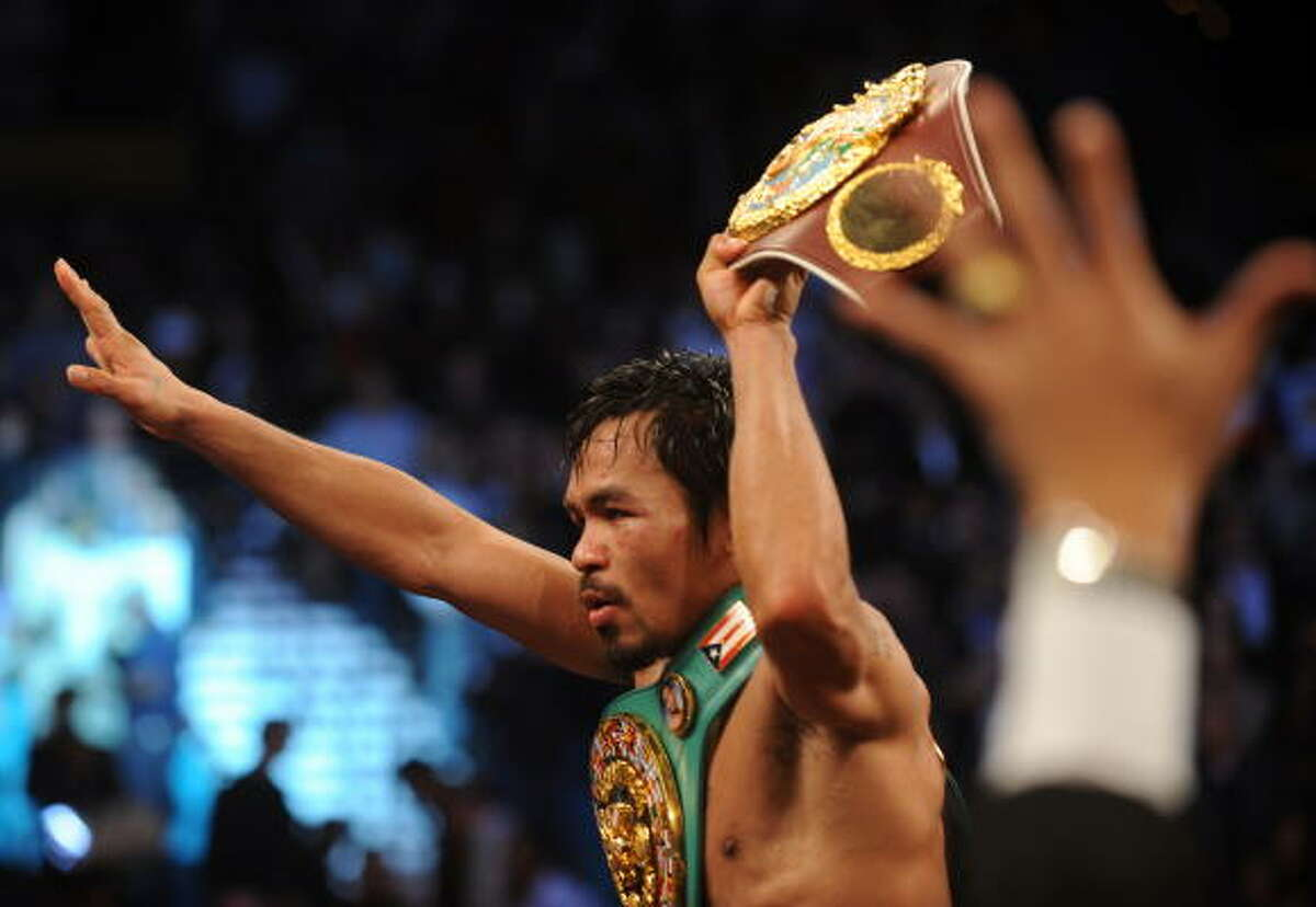 Manny Pacquiao celebrates his TKO of Miguel Cotto in their WBO welterweight title fight.