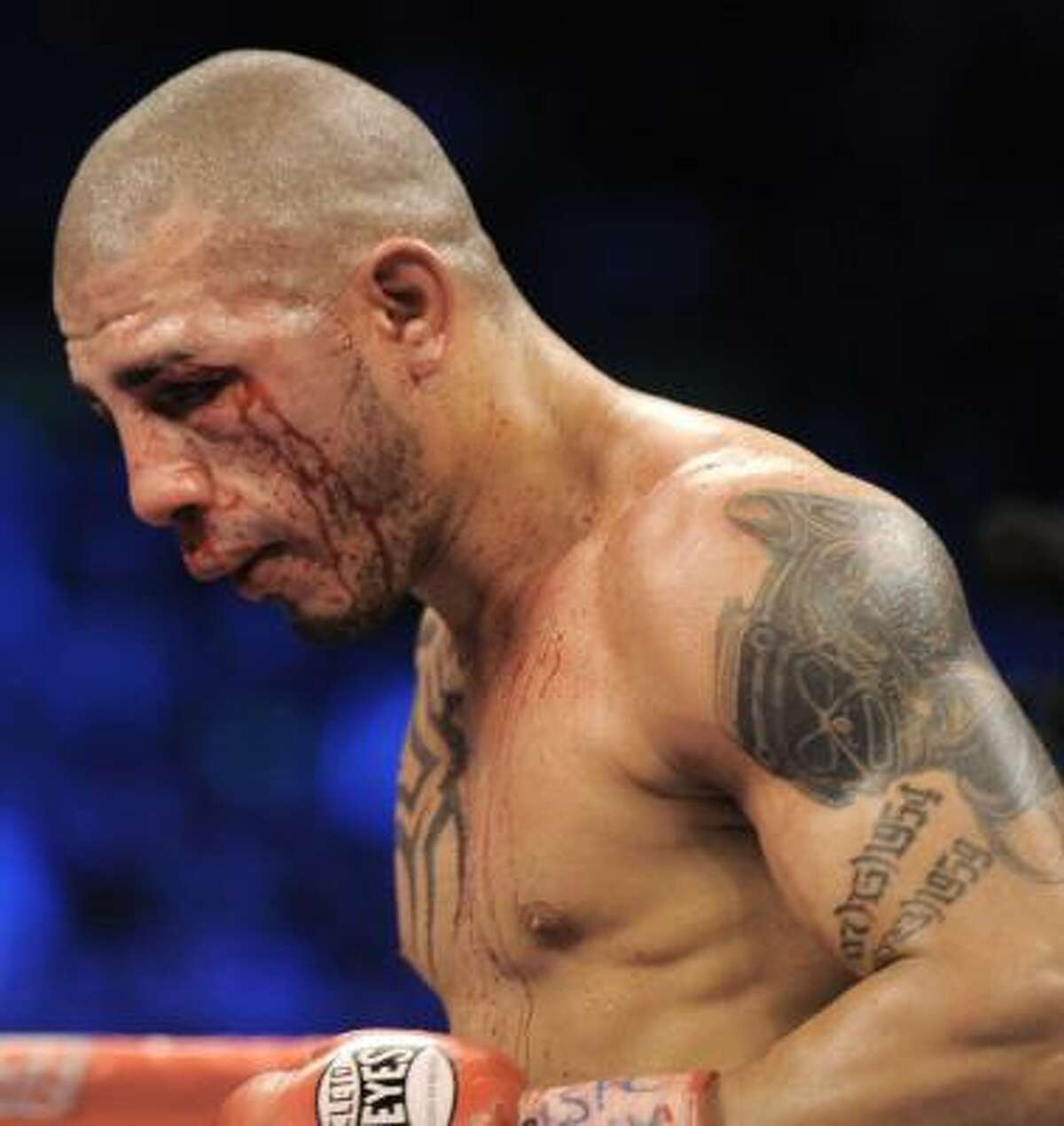 Miguel Cotto walks to his corner at the end of his fight against Manny Pacquiao.