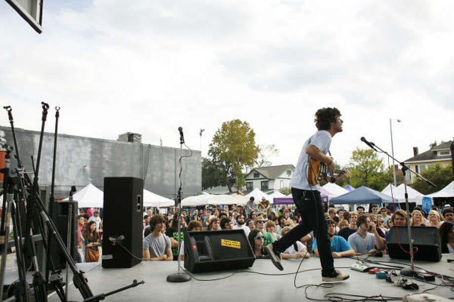 The band Caddywhompus performs at the Free Press Extravaganza, which lined up about 250 bands to play along the 300-500 blocks of Westheimer Road at venues such as Numbers, Mango's and Avant Garden. The event continues Sunday. Photo: Eric Kayne, For The Chronicle