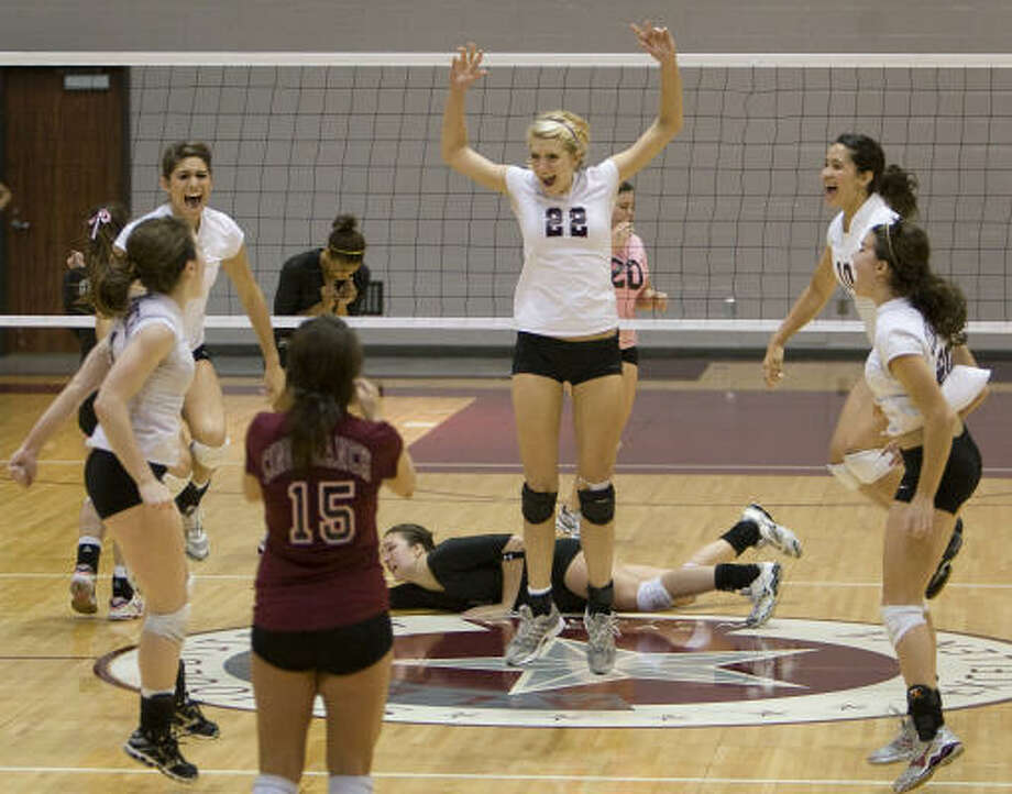 Cinco Ranch players, from left, Rachel Fairbanks (3), Ashley Meyer (5), Abby McGinnis (15), Jennifer Sanders (22), Erika Chin (10), and Kaitlyn Thurmann (20) celebrate winning the final point of the match. Photo: Smiley N. Pool, Houston Chronicle
