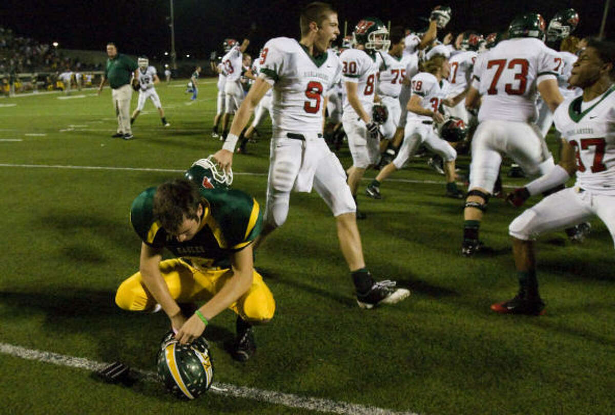 The Woodlands 32, Klein Forest 31 (OT) The Woodlands players storm the field in celebration behind Klein Forest kicker Jacob Decker after Decker's missed extra point attempt in overtime gave The Woodlands the victory.