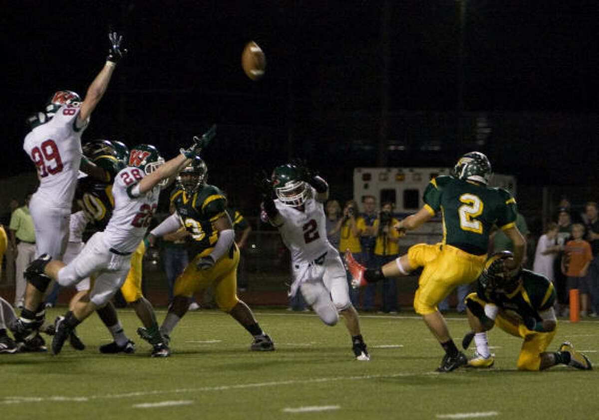Klein Forest kicker Jacob Decker misses an extra point attempt in overtime as The Woodlands won 32-31 in overtime.