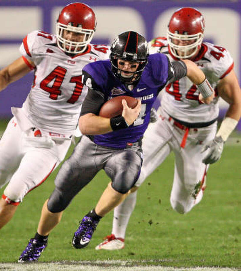 Texas Christian quarterback Andy Dalton (14) out runs Utah defenders Koa Misi (41) and Dave Kruger (44) in the first half of play at Amon G. Carter Stadium on Saturday. Photo: RON JENKINS, MCT