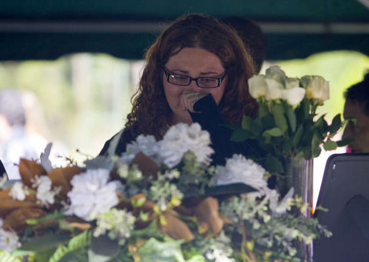 Andria Tidwell cries at the funeral of her cousin, Shara Torres, and Shara's daughter, Sarah.