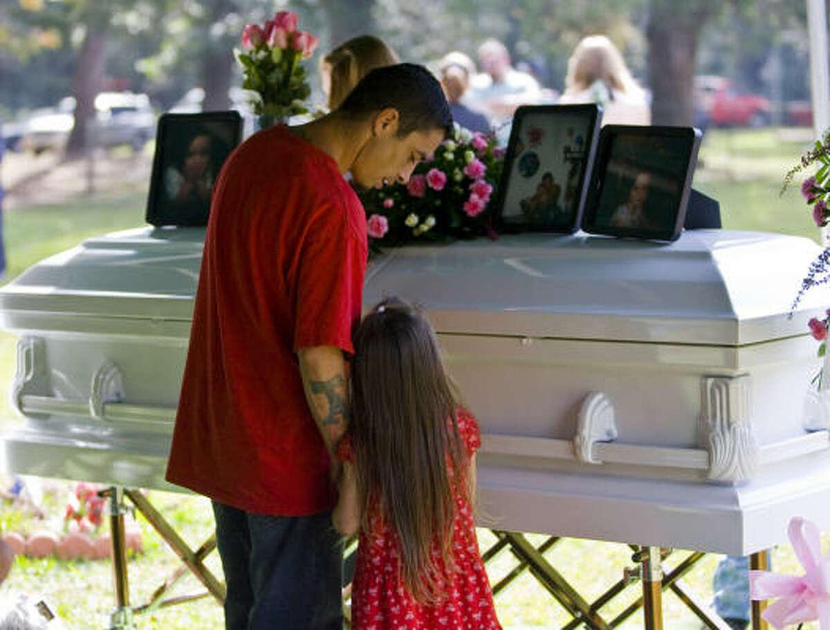 Milton Tabu Torres comforts his daughter, Valencia Faith Torres, 5.